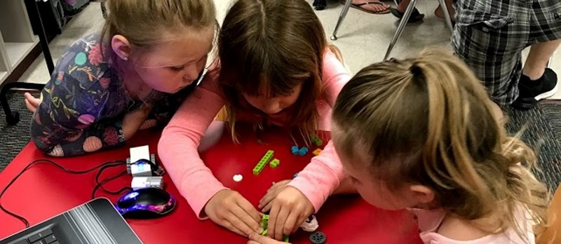 photo of students playing with legos