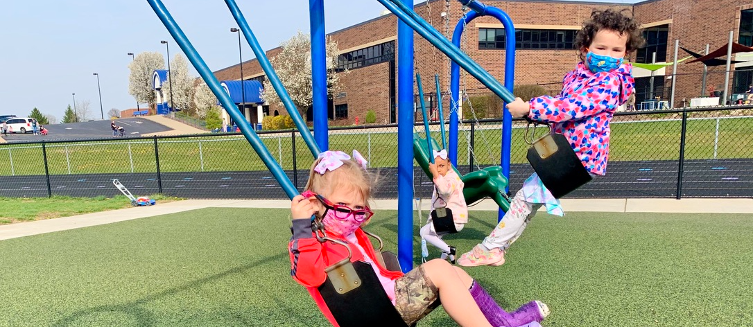 On an early spring morning, there's nothing quite like swinging to bring out some big smiles!