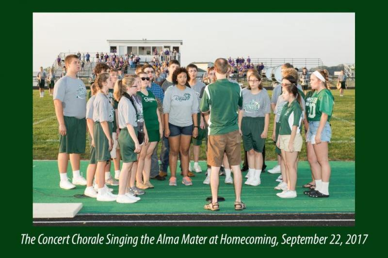 The concert chorale singing the Alma Mater at Homecoming, September 22, 2017