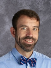 A photo of Principal Adam Raby.