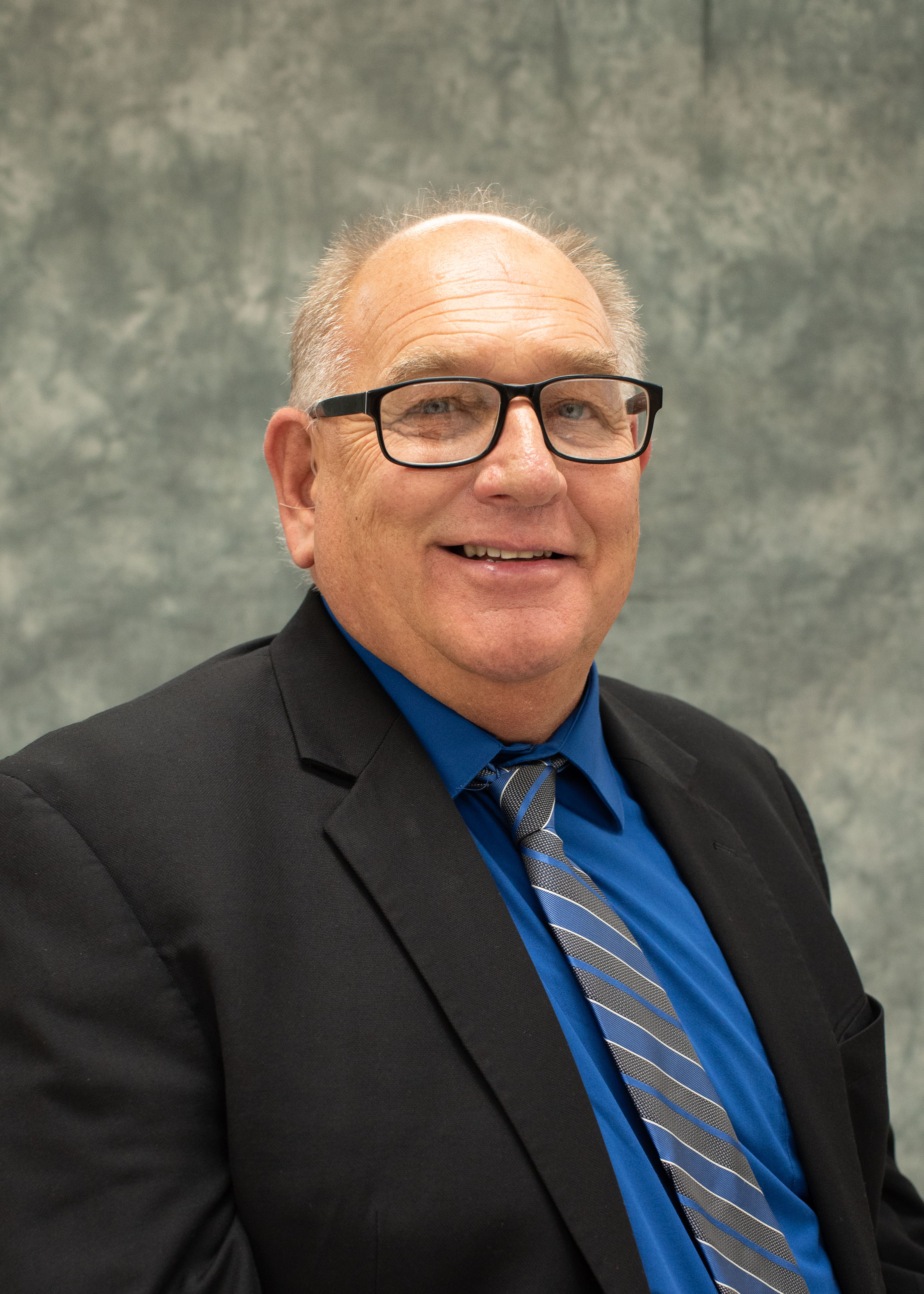 A photo of Terry Gibson, Board President.