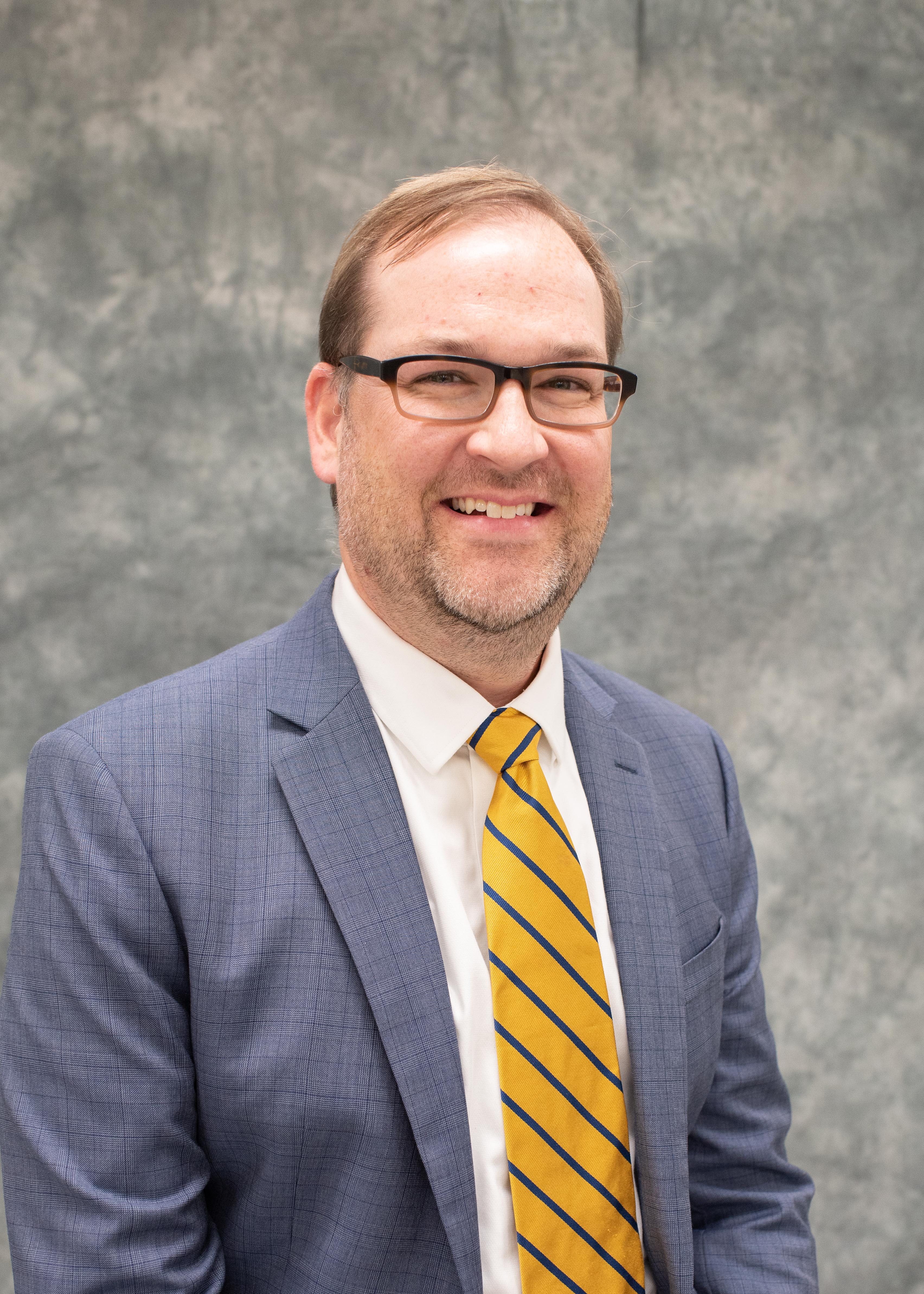 A photo of Justin Gibson, Director of Special Programs.