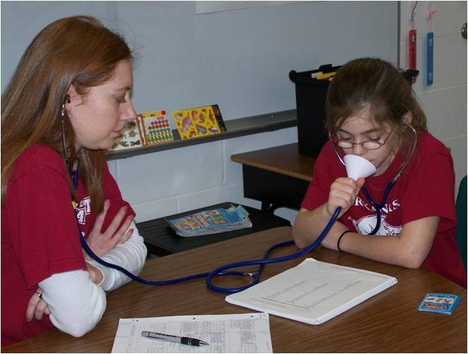 Photo of  a speech pathologist working with a student