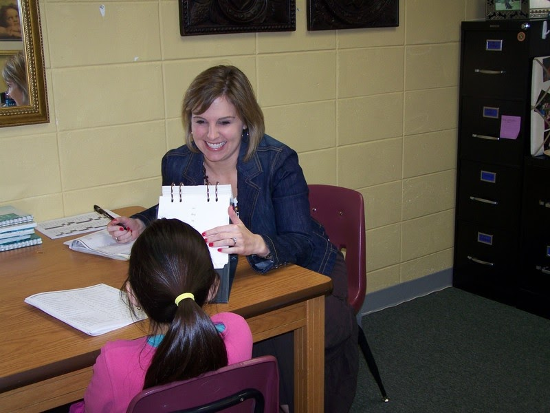 Photo of a school psychology specialist working with a student