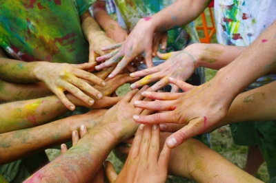 Photo of many hands together.