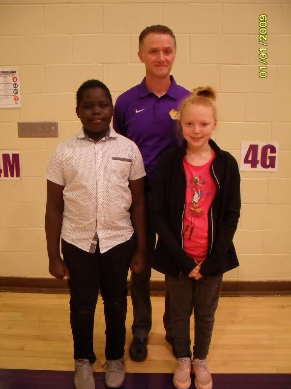 A photo of Miyom, Mr. Davis and Nadine.