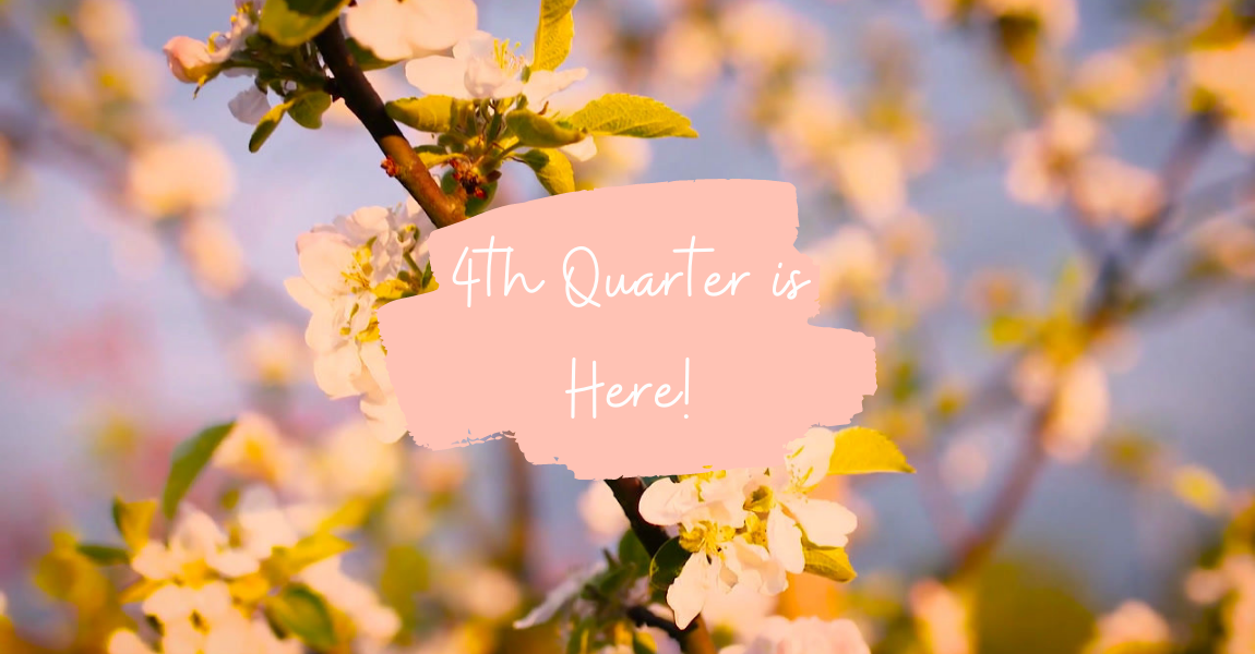 White letters saying '4th Quarter is here' on a pale pink swatch with flowering branches in the background