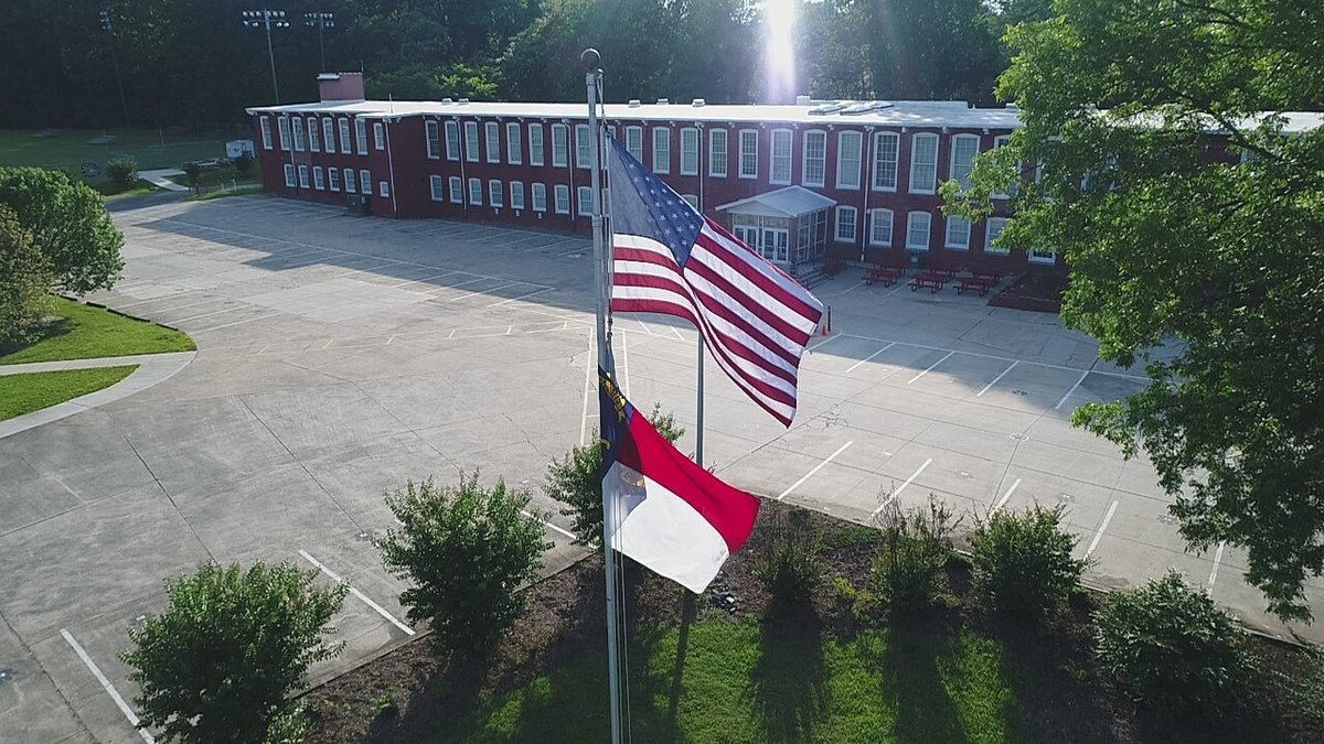 RCS with flags flying in front of the building
