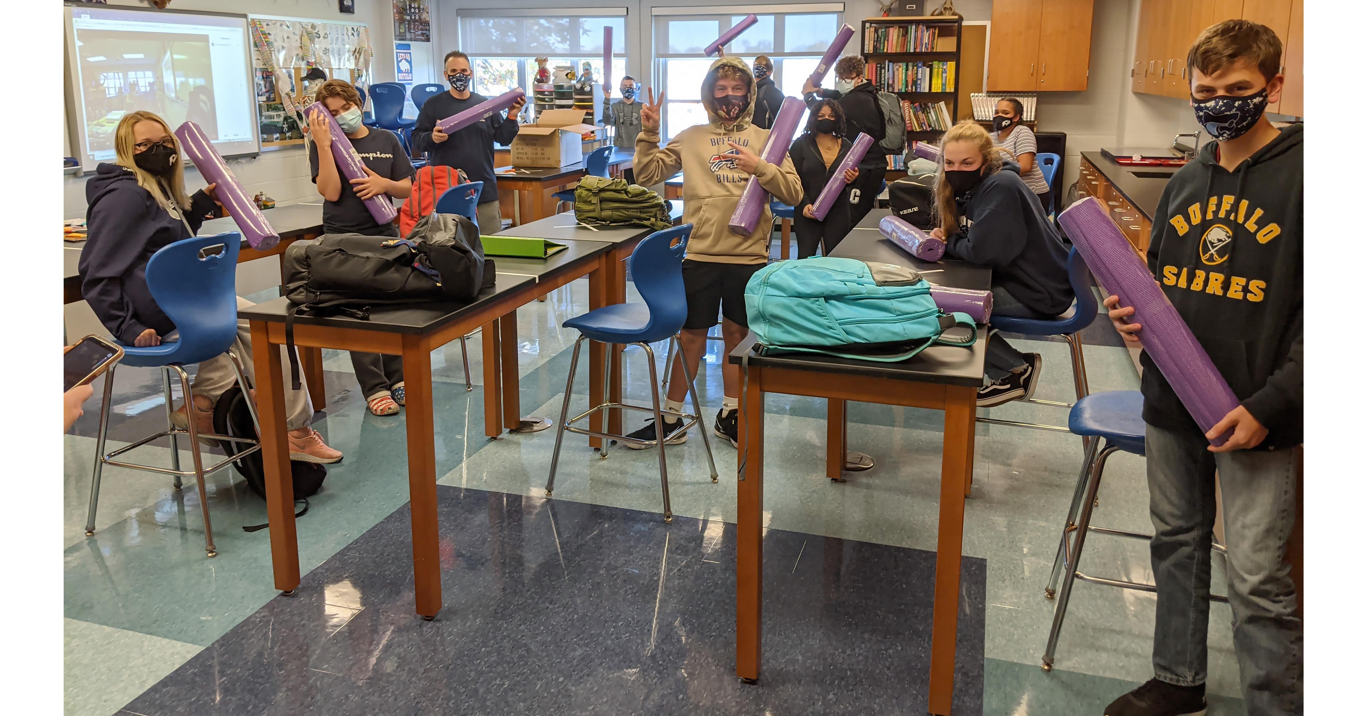 Yoga mat distribution in Mr. Grzybek's class.