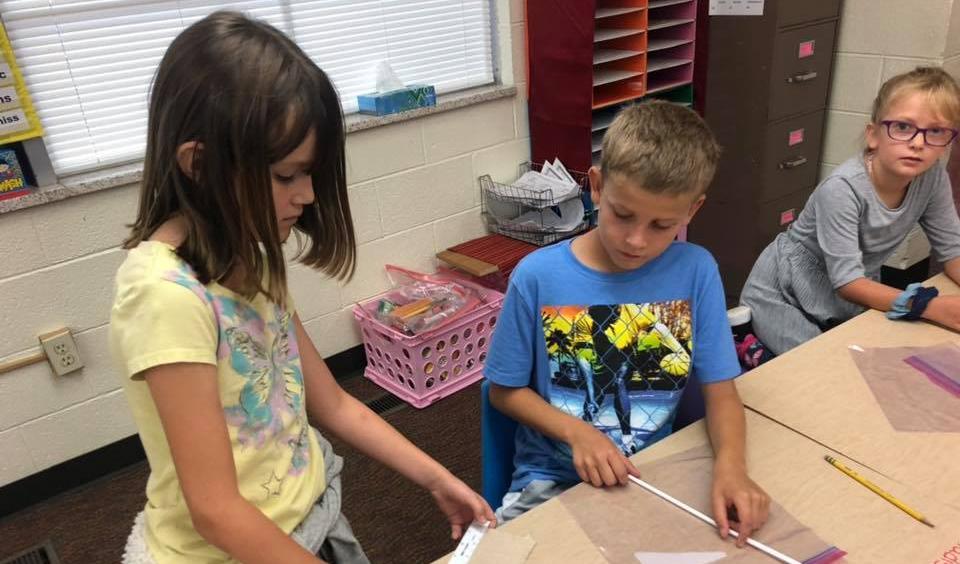 3rd grade students working