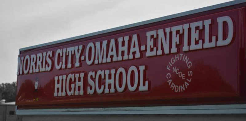 """An image with a sign """"Norris City-Omaha-Enfield High School""""."""