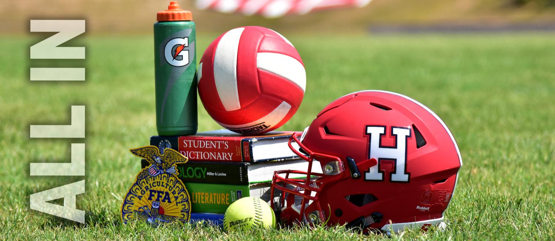 Books and sports stuff on field