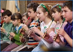 A photo of students playing instruments