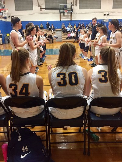 A photo of the girls basketball team at a game