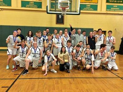 A photo of the basketball team with an award