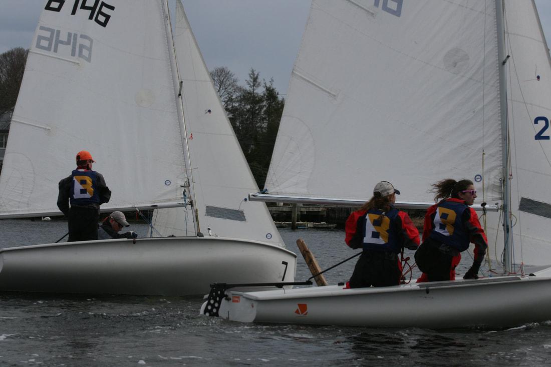 A photo of sailing club members on sailboats