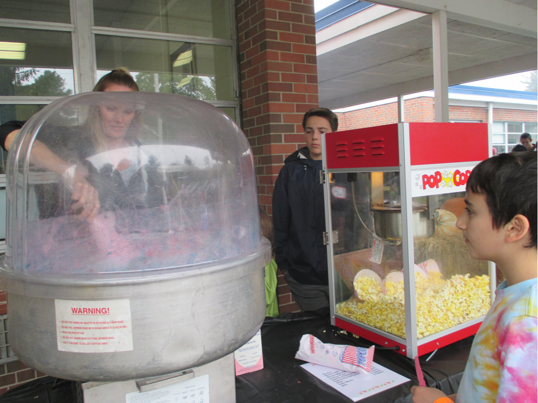 A photo of a student getting some cotton candy at an Interact Club event