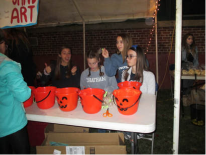A photo of students at an Interact Club halloween event