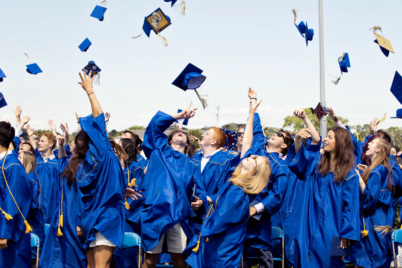 BHS graduates tossing caps