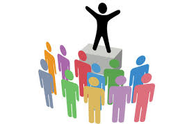 A graphic of a person standing on a podium in front of a crowd