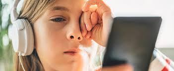 Photo of a girl rubbing her eye