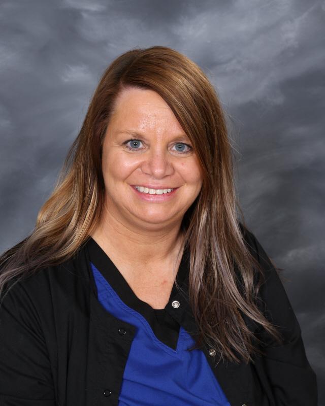 Mrs. Carlson, Nurse Aide