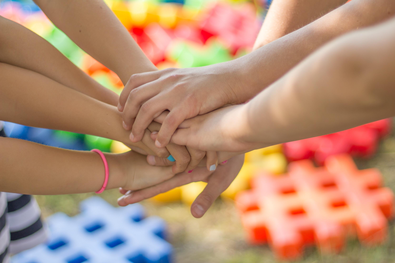 Teams putting hands together