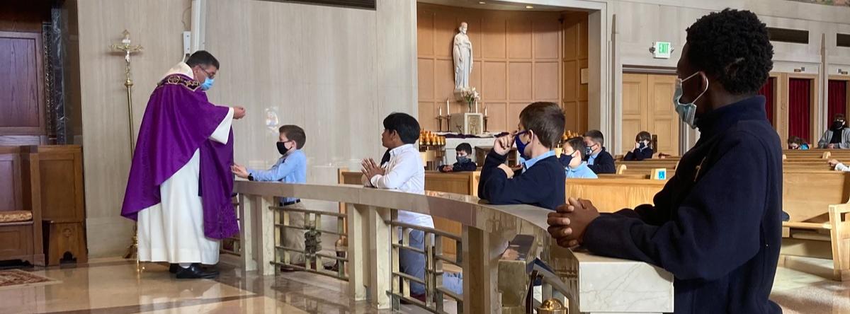 Priest serves communion