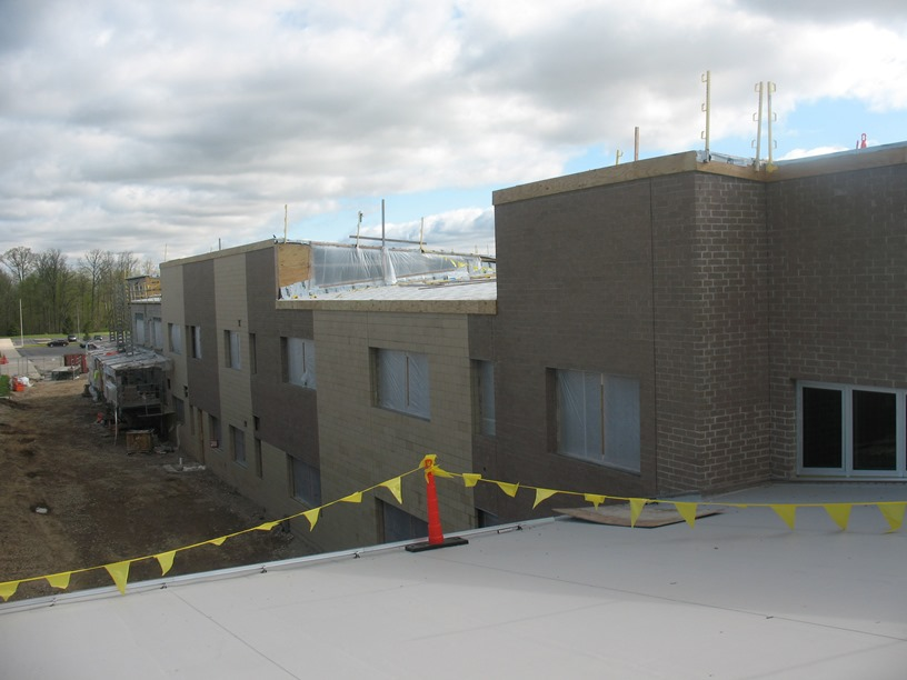 Photo of the view from the roof over the media center looking north at the courtyard that will be between the new building and old building.