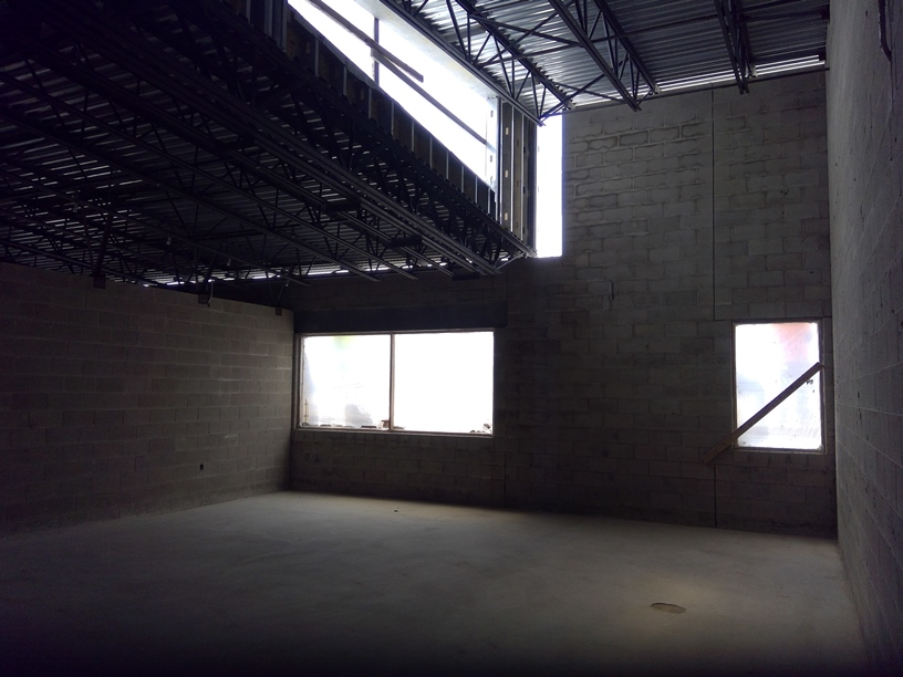 Photo of the Upstairs classroom with natural light from the roofline.