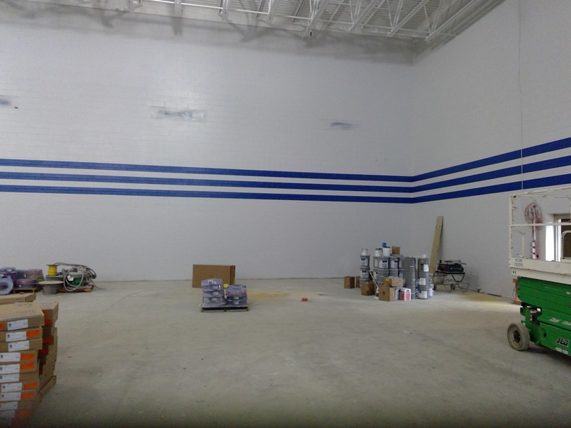 Photo of the Gym walls being painted.