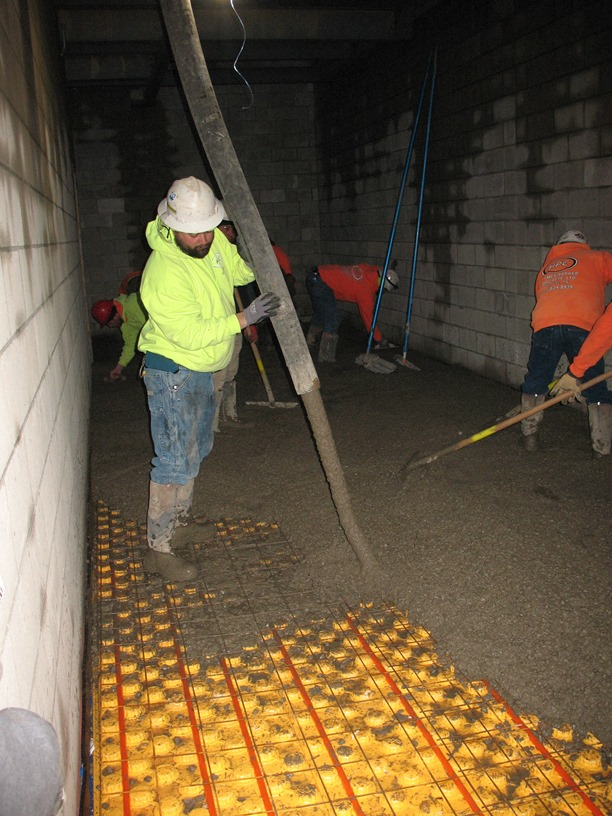 Photo of the radiant heat flooring in the locker rooms.