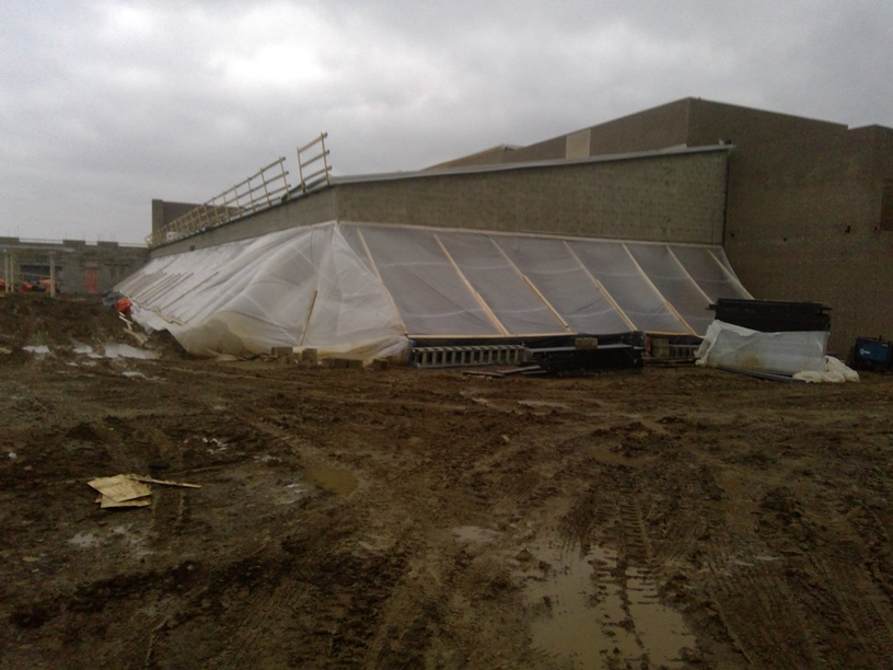 Photo of the School administrative offices tented in to do blockwork.