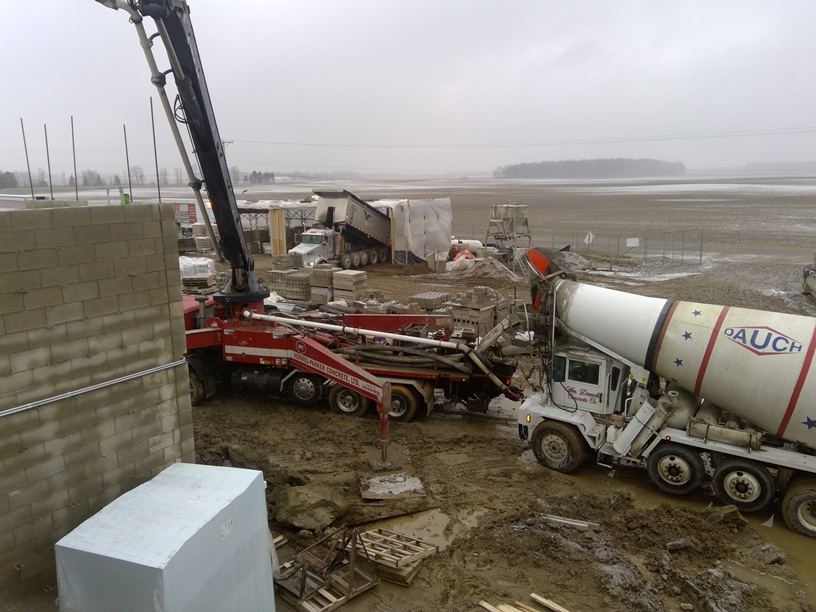 Photo of the Concrete truck feeding the pump.