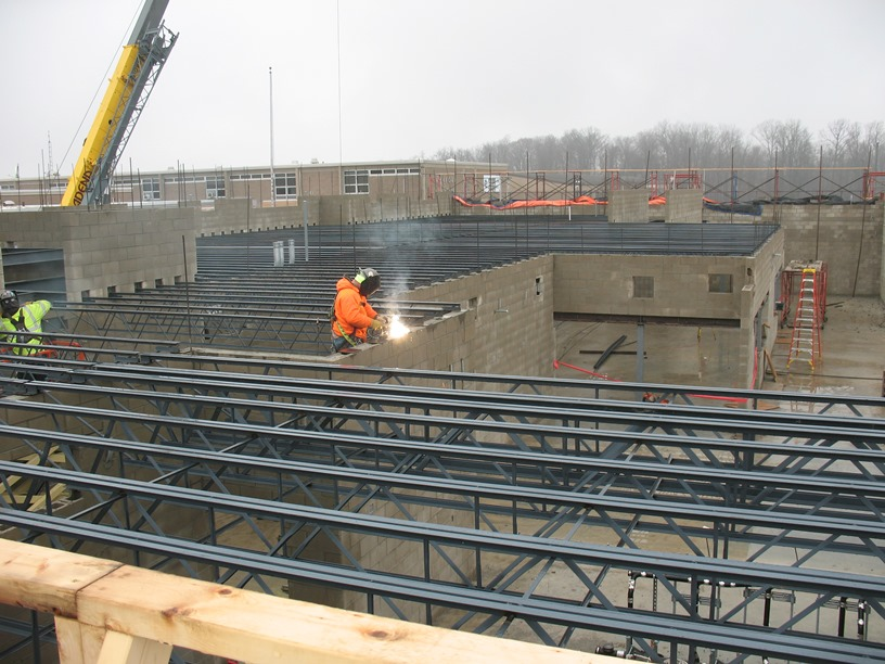Photo of the Girders being welded to wall plates.