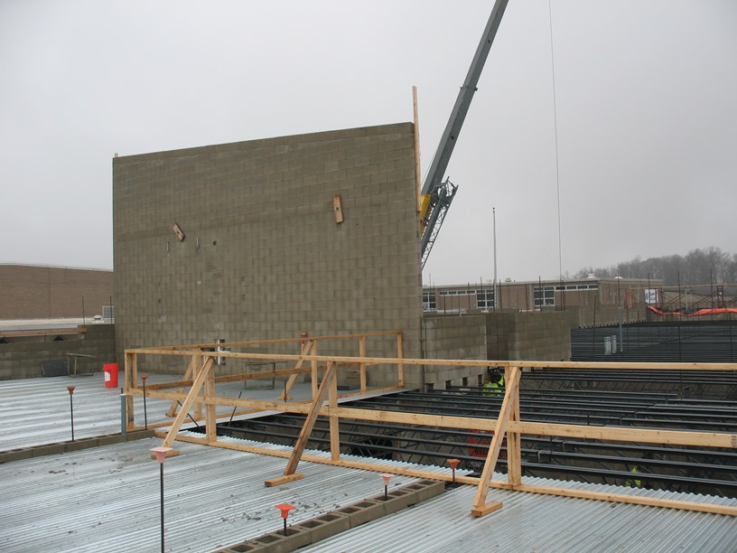 Photo of the Mechanical room wall built to finish height.