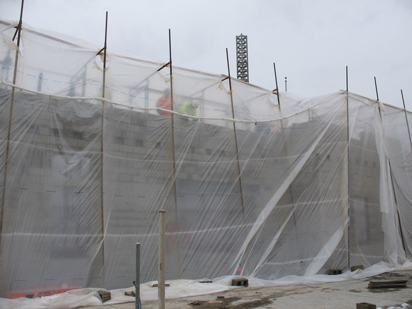 Photo of the Tented scaffolding heated to 65 degrees for construction.