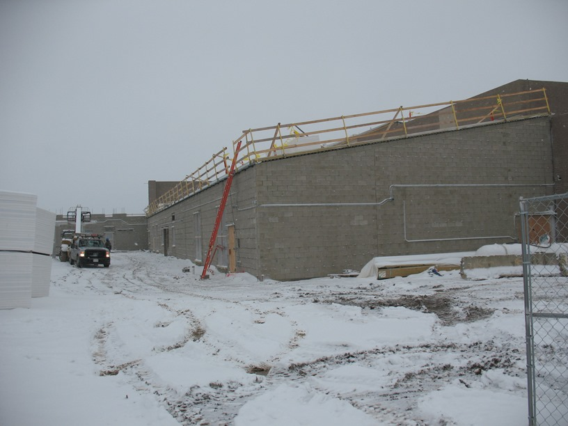 Photo of the Roof being installed over the band room, media center, and family and consumer science classrooms.