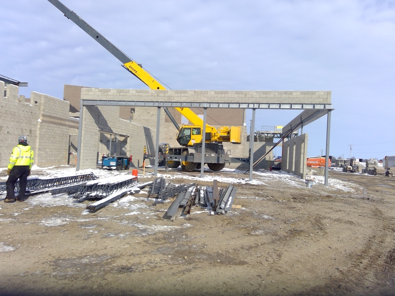 Photo of the setting steel in the cafeteria from inside the principal's office.
