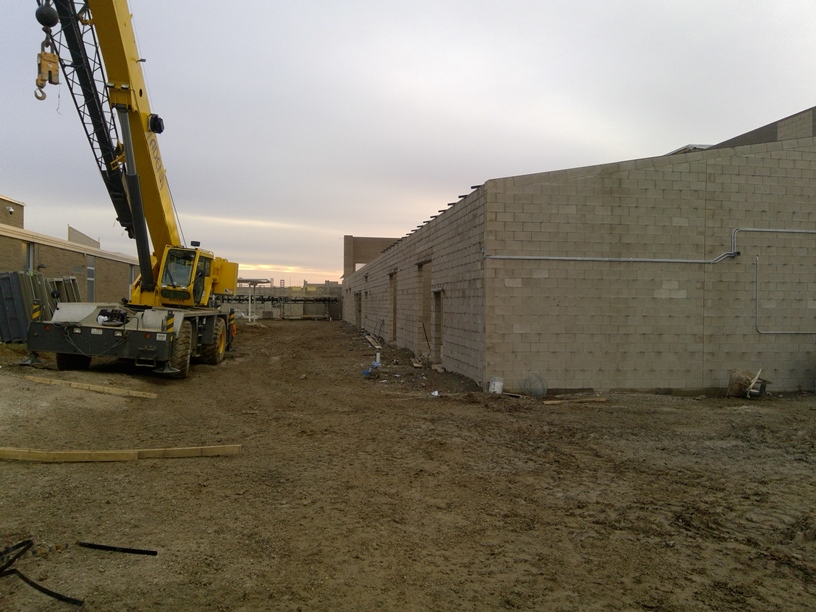 Photo of the Band room and future courtyard between the buildings.