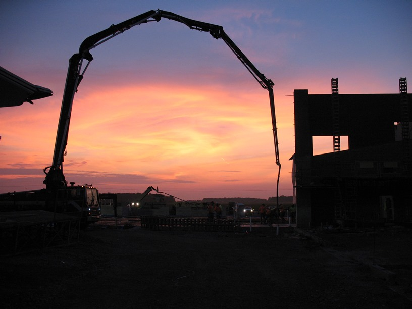 Photo of the Sunrise over the academic wing as the floor was being poured.