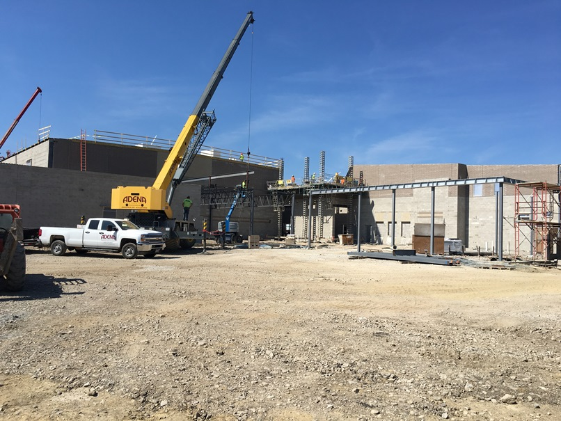 Photo of the crane is setting the girders over the cafeteria.