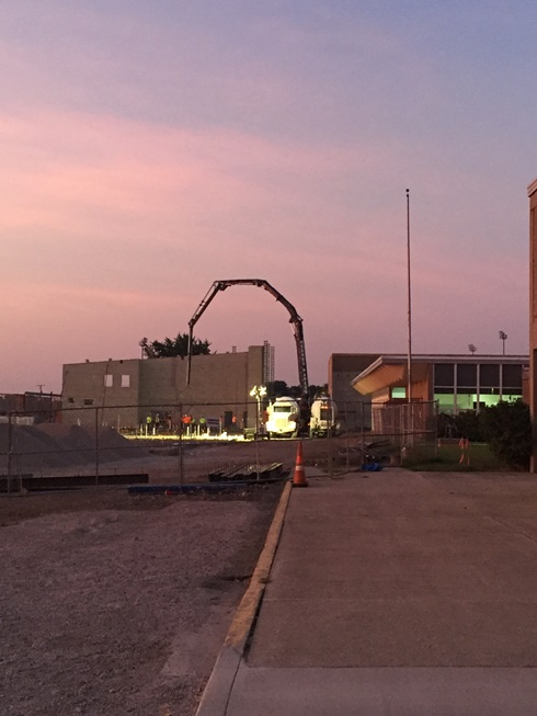 Photo of the Early morning pouring of concrete in the new academic wing.