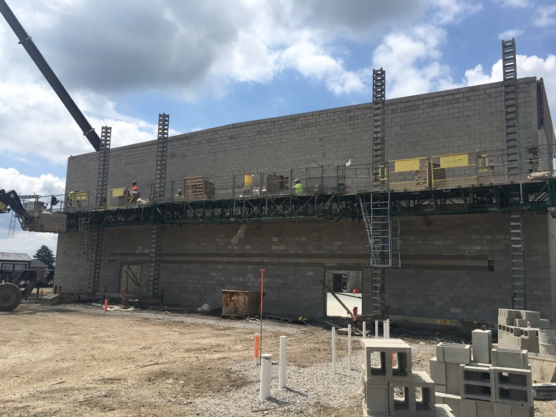Photo of the East wall of the new gym entering from future cafeteria.