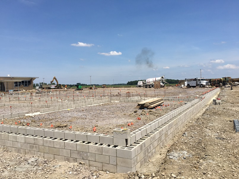 Photo of the Foundation for new gym, band room, locker rooms, and cafeteria.