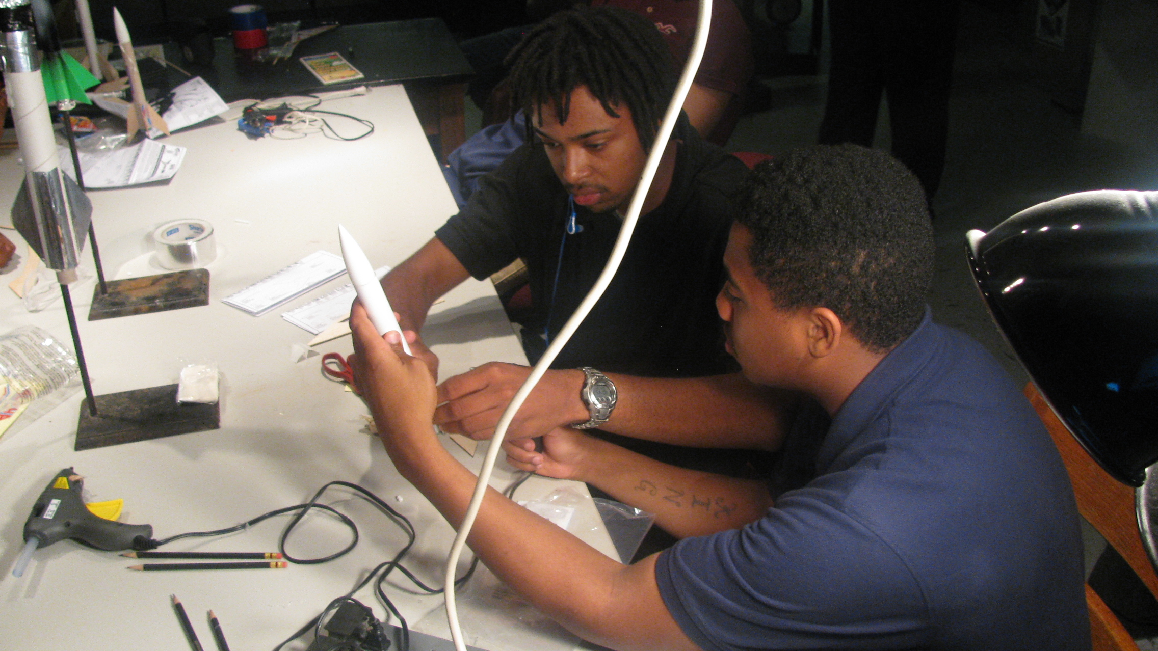 two students creating  rocket in class