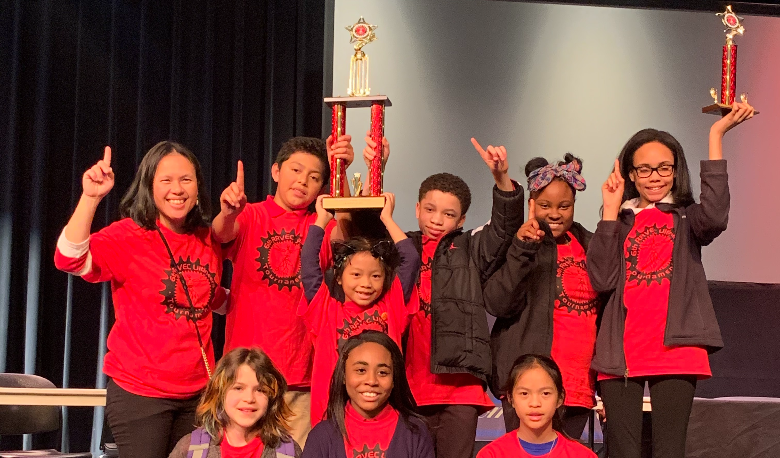 Northside K-8 Students at a competition winning a tropy
