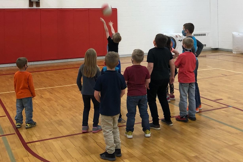 red raider care children in gym