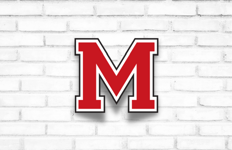 M on Brick Wall
