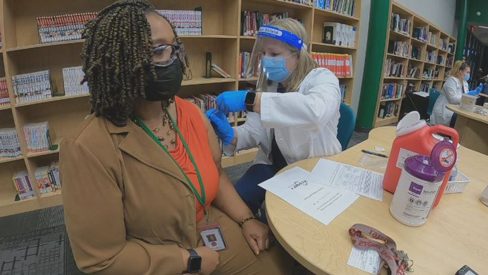 school employee getting vaccinated